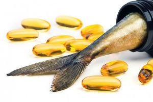 Капсулы омега 3 и хвост рыбы
